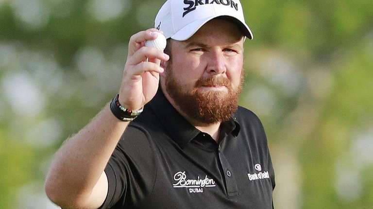 Shane Lowry of Ireland reacts after a birdie