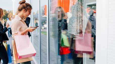Girl using a mobile phone before entering the