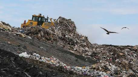 A plow is used to move waste at