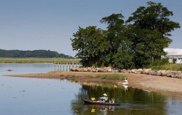 A man rows away from shore at Stony