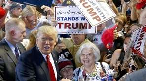 Republican presidential candidate Donald Trump, left, shouts to