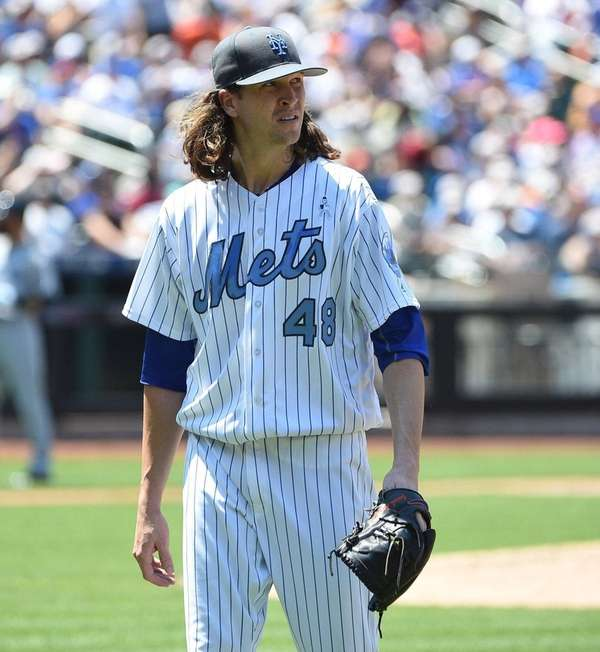 New York Mets pitcher Jacob deGrom walks to