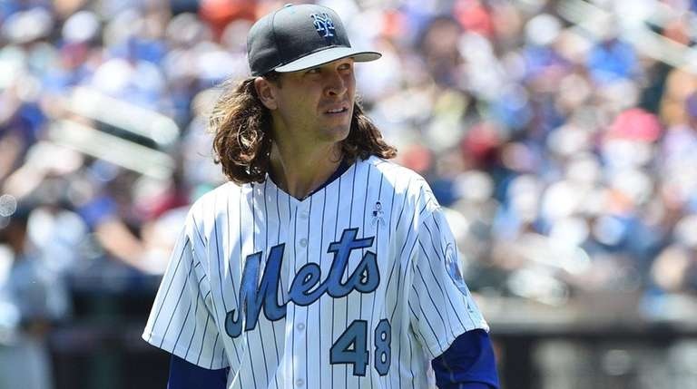 New York Mets pitcher Jacob deGrom walks to