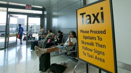 A sign directs travelers to a temporary taxi