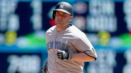 Catcher Brian McCann of the Yankees rounds the