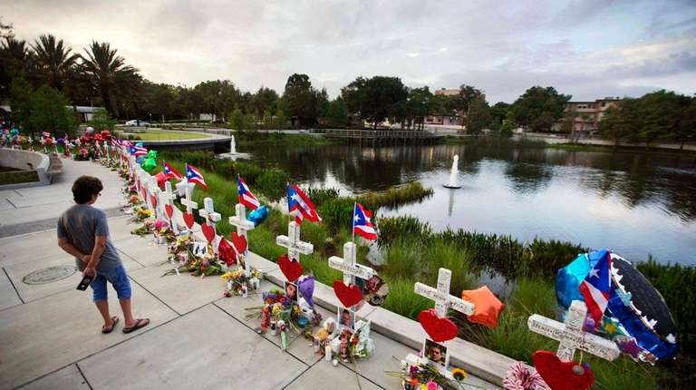 Crosses, one for each victim, line a walkway