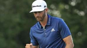 Dustin Johnson reacts after a par save on