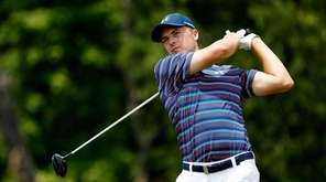 Jordan Spieth of the United States plays his