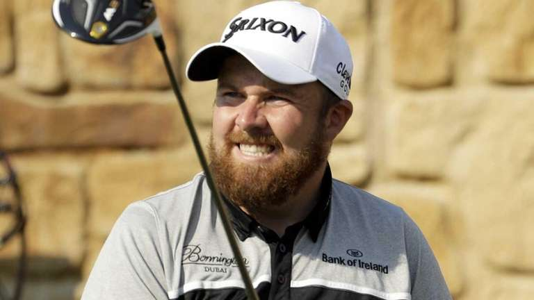Shane Lowry, of the Republic of Ireland, watches