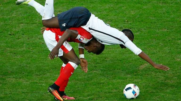 Paul Pogba (top) of France and Breel Embolo