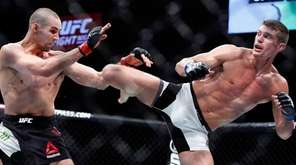 Stephen Thompson, right, kicks to the body of
