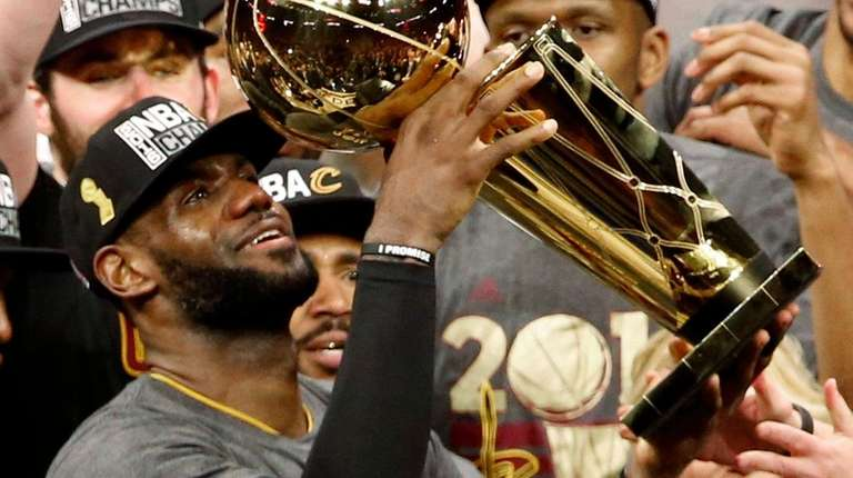 Cleveland Cavaliers player LeBron James holds up the