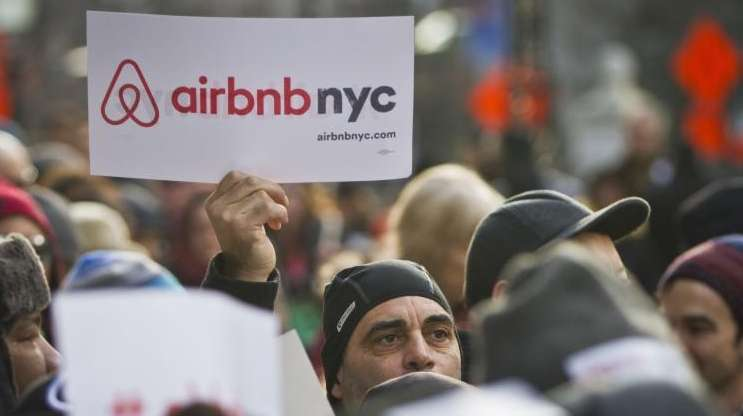 Supporters of Airbnb hold a rally outside City