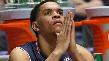 Auburn's Tyler Harris sits on the bench during