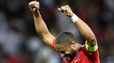 Wales' defender Ashley Williams celebrates their 3-0 win