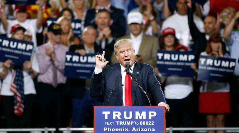 Republican presidential candidate Donald Trump speaks to a