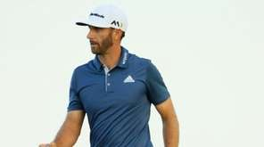 Dustin Johnson of the United States reacts to