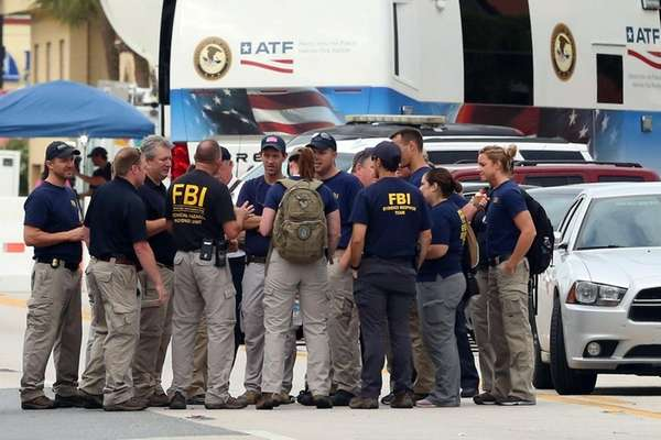 FBI agents gather early Monday, June 20, 2016,