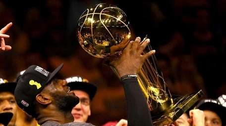 LeBron James of the Cleveland Cavaliers holds