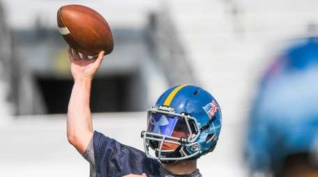 Quarterback Ryan Klemm from Newfield throws during an
