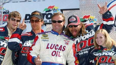 NASCAR driver Mike Wallace, center, poses with celebrities