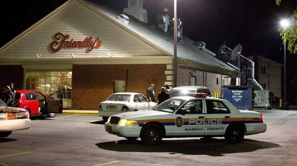 Nassau County police respond to a reported robbery