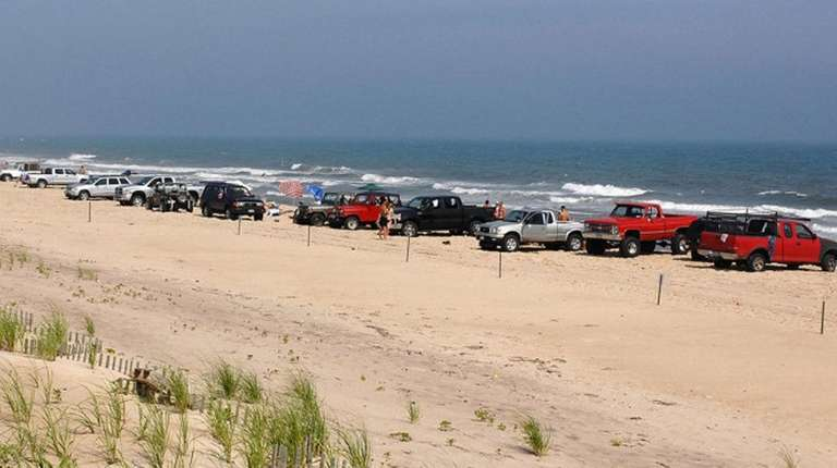 Trucks line the beach on the ocean east
