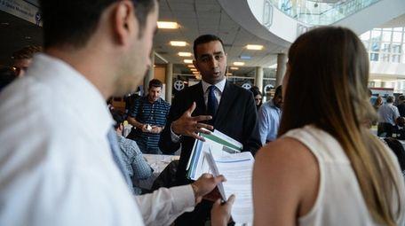Sonny Parikh, of NJ, speaks with representatives from