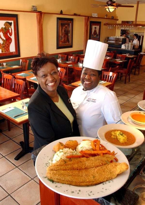 Lillian and Leisa Dent serve Southern-fried catfish with