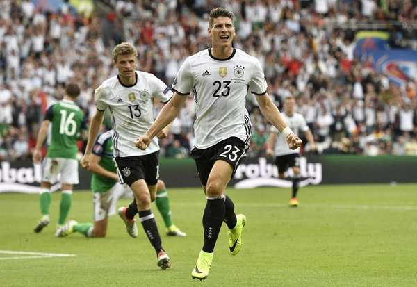 Germany's Mario Gomez celebrates after scoring the opening