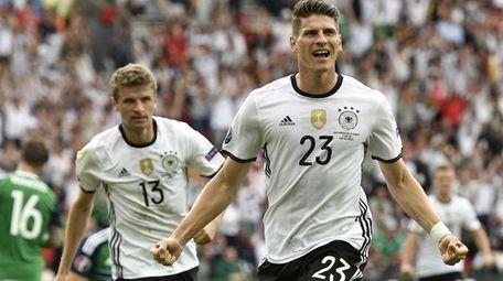 Germany's Mario Gomez celebrates after scoring the opening