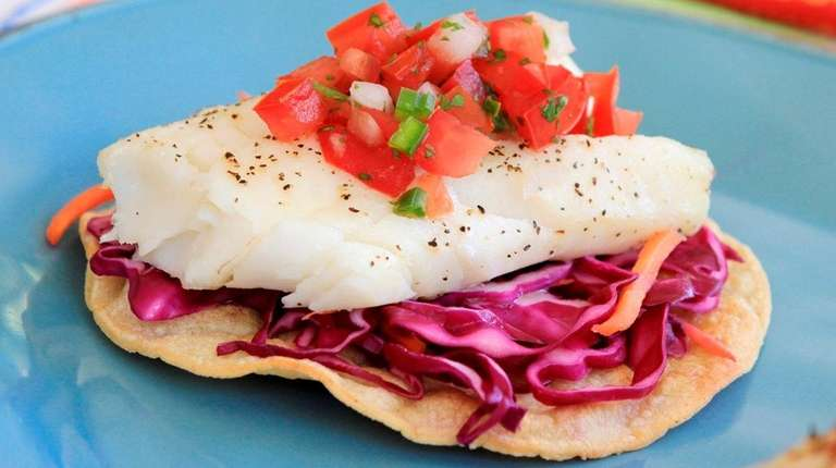 Baked corn tortillas topped with cabbage salad, baked