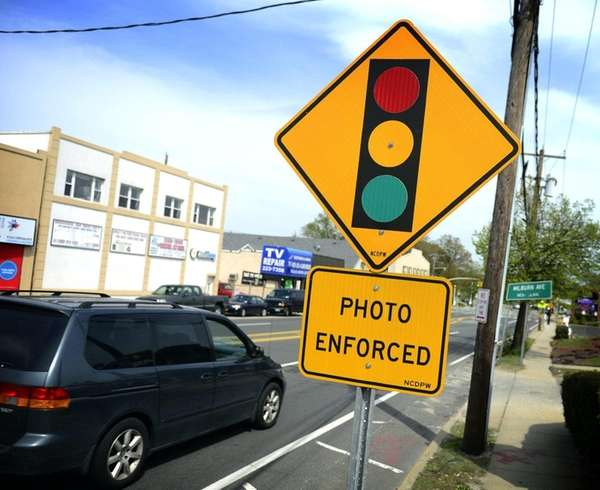 A red-light traffic camera sign is pictured at