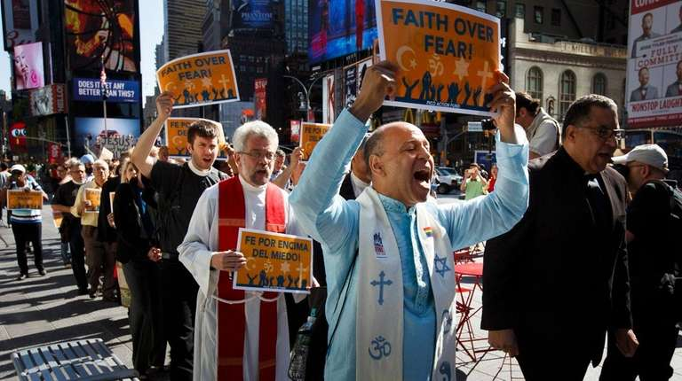 A group of people representing multiple religious faiths