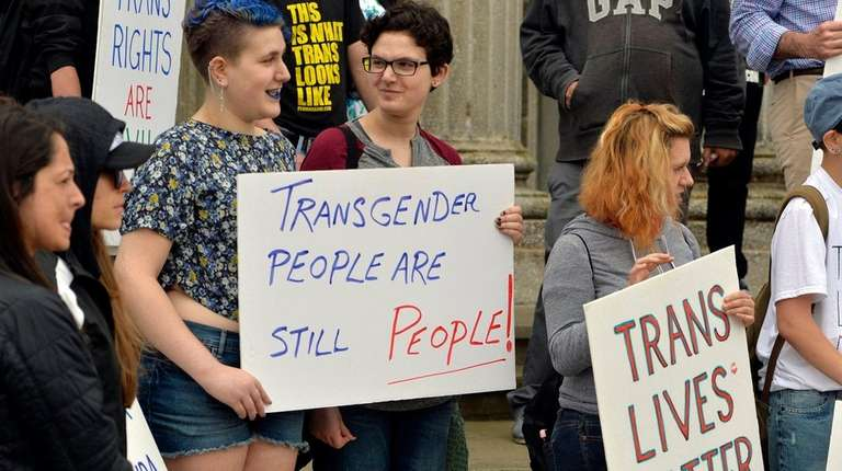 Transgender community supporters attend a rally on the