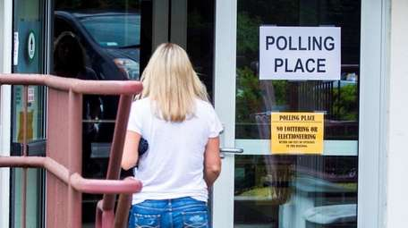 A woman arrives to cast her vote on