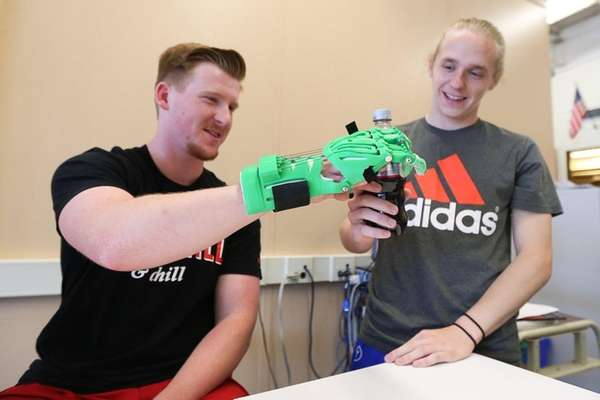 Senior Kyle Wappaus, 17, left, demonstrates use of