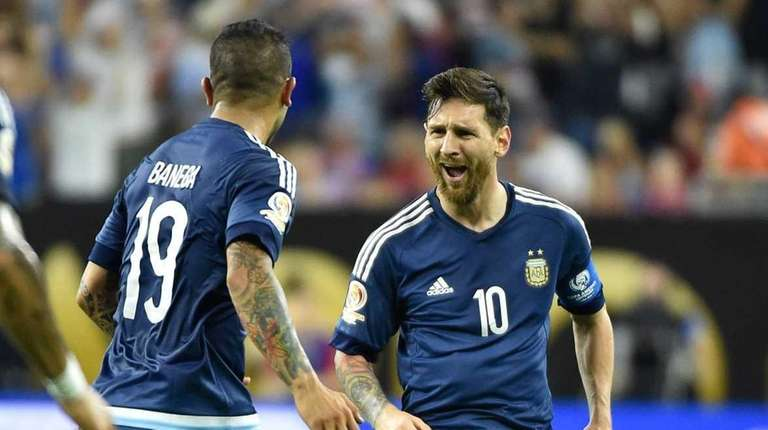 Argentina's Lionel Messi (R) celebrates with teammates after