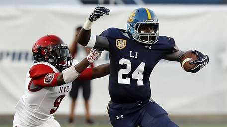 Long Island's Infinite Tucker (24) breaks the tackle