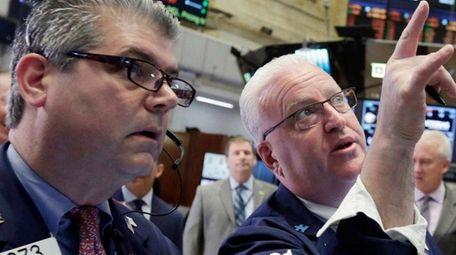 Traders John Panin, left, and Thomas Ferrigno work