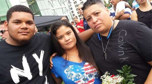 Marie Aponte, right, her fiancee Chrystal Sandi and