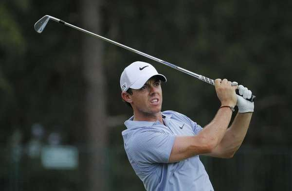 Rory McIlroy watches his tee shot on the