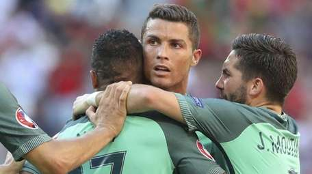 Portugal's Nani, second from left, celebrates with teammates