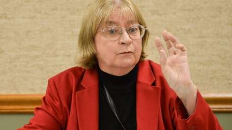 Barbara Donovan speaks to village residents during a