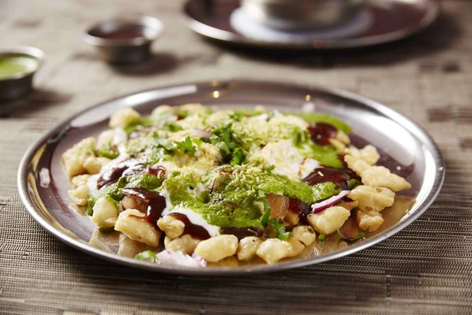 Papri chaat, a snack of crisped rise topped