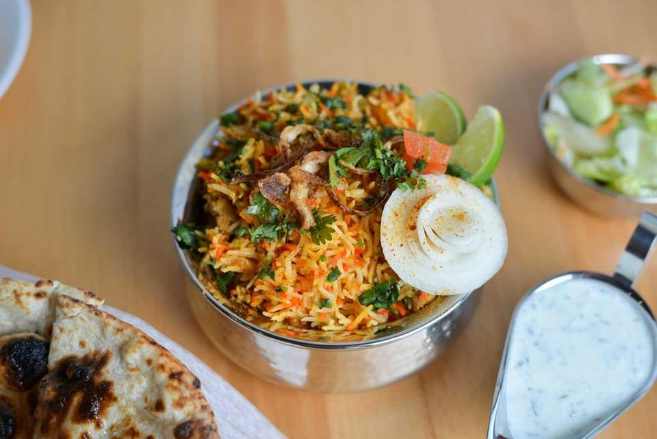 Chicken Biyriani garnished with fried onion and lime
