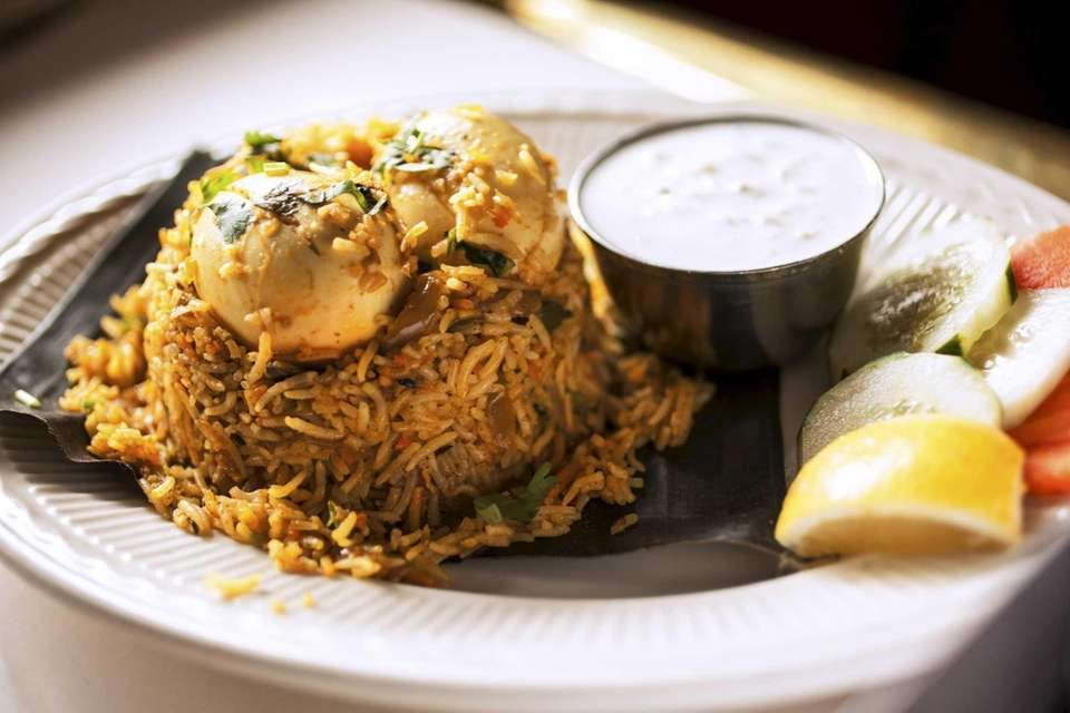 Egg biryani is served at Southern Spice in