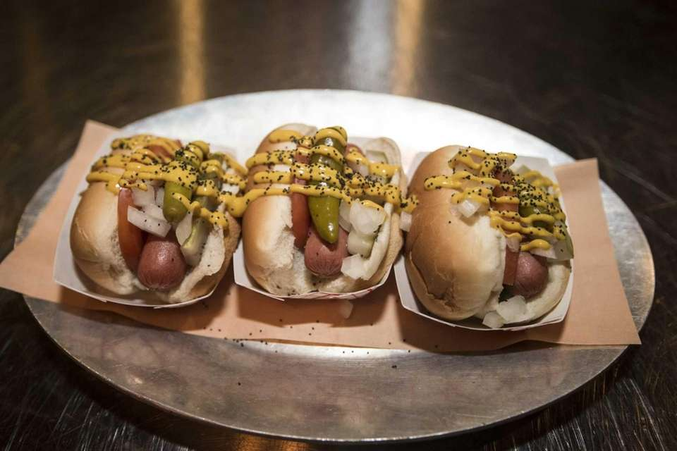 Mini Chicago hot dog sliders are served at