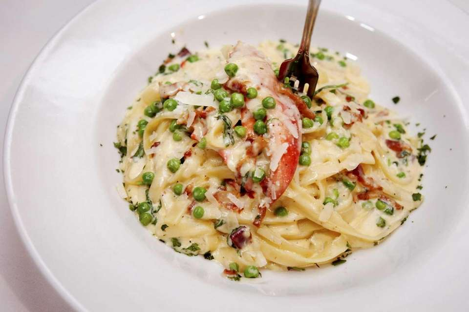 Lobster fettuccine carbonara is served at Heirloom Tavern