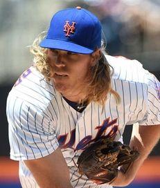 New York Mets starting pitcher Noah Syndergaard follows
